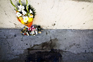 Bouquet of flowers with candles on Nogales (Mexico) sidewalk